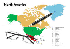 Denmark on north america map. With pen & eyeglasses Royalty Free Stock Images