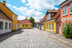 Denmark. Odense, Denmark - July 21, 2015: Traditional houses in the old town with the Hans Christian Andersen home in the background left Stock Images