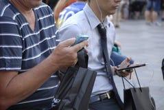 DENMARK_PHOTO FEATURES_LIFE CON GLI SMARTPHONES Immagini Stock Libere da Diritti