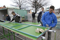 DENMARK_polish workers. COPENHAGEN /DENMARK- Polish manual male workers working on sport event nailing commercial billbard at christiansborg slots plads 25 royalty free stock photo