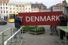 DENMARK_polish workers. COPENHAGEN /DENMARK- Polish manual male workers working on sport event nailing commercial billbard at christiansborg slots plads 25 stock images