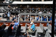 DENMARK`S WEATHER_SUN SHINE BOAT CRUSING TOURISTS. Copenhagen/Denmark 25.May 2018_ Foreign and local tourists enjoy boat canal crusing in Christianshavn canal in Royalty Free Stock Image