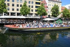 DENMARK`S WEATHER_SUN SHINE BOAT CRUSING TOURISTS. Copenhagen/Denmark 25.May 2018_ Foreign and local tourists enjoy boat canal crusing in Christianshavn canal in Stock Image