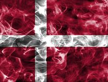 Denmark smoke flag with a black background. Denmark smoke flag isolated on a black background. Denmark smoke flag Royalty Free Stock Image
