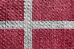 Denmark Textile Industry Or Politics Concept: Danish Flag Denim Jeans. Background Texture stock images