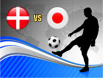 Denmark versus Japan on Blue Abstract World Map Background Royalty Free Stock Photos