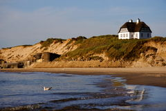 Denmark -White beach house Stock Photos