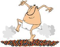Man som går på hoade kol Arkivfoton