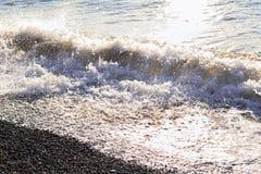 Denna kipiel na otoczak plaży Obrazy Stock