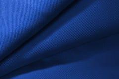 Denna textur för tyg för bildslut övre blåa Arkivbilder