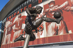 Dennis Bergkamp statue Arsenal Emirates Stadium. Dennis Bergkamp statue outside Emirates Stadium Ashburton Grove, North London, UK. Home of Premier League Royalty Free Stock Image
