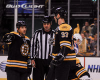 Dennis Wideman and Zdeno Chara. Bruins defensemen Dennis Wideman and Zdeno Chara speak with a linesman Royalty Free Stock Photography