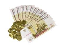 Denominações e as moedas. Fotografia de Stock Royalty Free