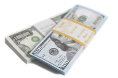 Denominación en un millón y cientos dólares de cuentas con la cinta imagen de archivo libre de regalías