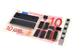 The denomination 10 euros and electronic circuits. Royalty Free Stock Images