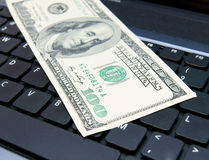 Denomination (dollar) on the laptop. Royalty Free Stock Photography