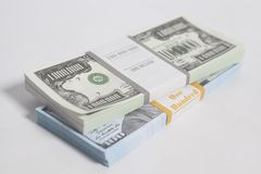 Denomination in one million and one hundred dollars bills with tape. Denomination in one million dollars bills with tape isolated on white background royalty free stock images