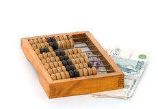 Denominations and an abacus. Stock Photography