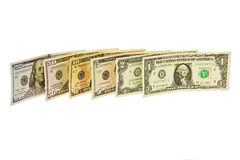 Denominations dollars of various denominations standing vertical. Banknotes, one, two, five, ten, fifty and a hundred dollars Royalty Free Stock Photography