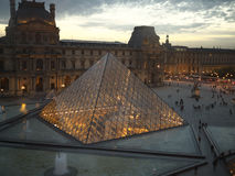Denon wing and pyramid of Louvre Museum at dusk Royalty Free Stock Photography