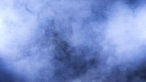 Dense abstract fumes and smoke on black background