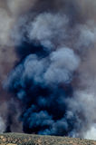 Dense Black Smoke Rising from the Raging Wildfire Royalty Free Stock Images