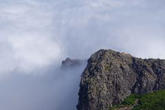 Dense clouds on the Pico do Arieiro mountain. Madeira island. Dense clouds on the Pico do Arieiro mountain. Portuguese island of Madeira royalty free stock images