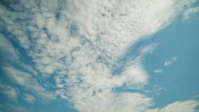 Dense clouds quickly swim through the summer sky. time lapse stock footage