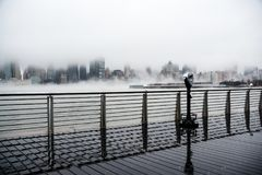 A dense fog covered New York City during the winter`s day on January of 2018. View of Manhattan and Roosevelt Island Royalty Free Stock Image