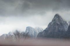 Dense fog over Bucegi mountains. Dreamy landscape Stock Photography