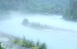 Dense fog over river. Royalty Free Stock Photography