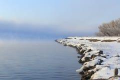 Dense fog over the river Stock Photos