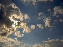 Dense gray clouds hiding the su royalty free stock image