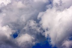 Dense and great white clouds on a beautiful summer blue sky stock image