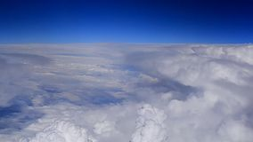Dense large clouds from airplane. Dense large clouds view from airplane stock video