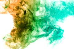 Background from the smoke of vape. Dense multicolored smoke of blue, green and yellow colors on a white isolated background. Background of smoke vape stock images
