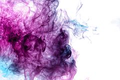 Abstract art colored blue and pink smoke on black isolated background. stock photography