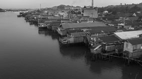 Dense neighborhood of wooden houses on Mahakam riverbank, Borneo, Indonesia. Black and white Royalty Free Stock Photos