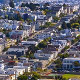 Dense residential area in San Francisco California. View of houses in a dense neighborhood in San Francisco, California. Power lines and trees line sunny royalty free stock photography