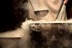 Dense steam over pot. Dense steam over cooking pot Stock Image