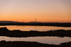 Dense sunset light over San Francisco Bay Wetlands Stock Image