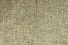 The dense texture of the old burlap, a fabric made of flax royalty free stock image