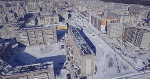 Dense urban development of poor high-rise buildings from air. Dense urban development of a poor district in city with high-rise buildings on a sunny winter day stock video