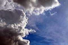 Density vesus soft cloud. The dark clouds is coming over the blue sky Stock Image