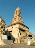 Densus old church in Romania. One of the oldest church in Romania is build from river rocks, bricks with Roman inscriptions, funerary stones, canalisation, taken Royalty Free Stock Photo