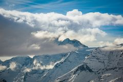 Dent Blanche mountain in the clouds. The Dent Blanche mountain with it`s summit in the clouds, culminating at 4`357 meters, Valais, Switzerland stock image