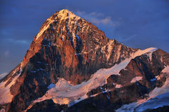 Dent Blanche West Face. The west face, and south and north ridges of the Dent Blanche (4357m) in the Swiss Alps at sunset, seen from the Bertol Refuge Stock Image