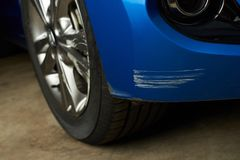Dent car scratch. Close-up. Crashed car in accident stock photos