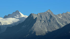 Dent d'Herens. The Dent d'Herens (left) and the Aiguille de la Tsa (right) in the southern swiss alps above Sion Royalty Free Stock Images