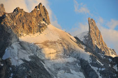 Dent du Geant. The legendary climbing peak, the great slab of the Dent du Geant (r) (giant's tooth)  with the aiguille du Tacul (l) in the french alps above Royalty Free Stock Photography